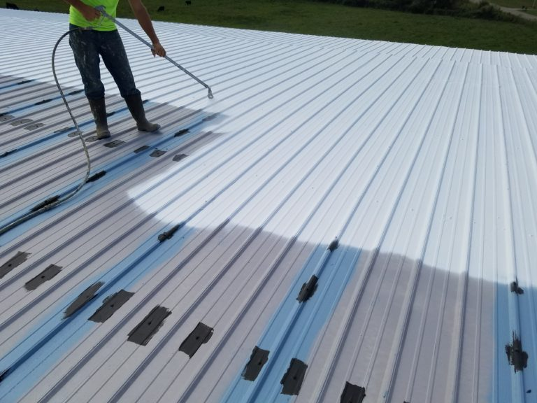 Commercial roofing contractor applying product.