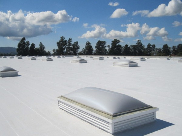 Fabric reinforced membrane roofing.
