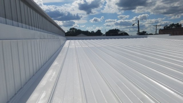 Metal roof restoration completed.